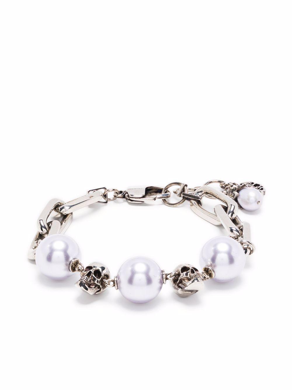 Bracciale con perle e teschi