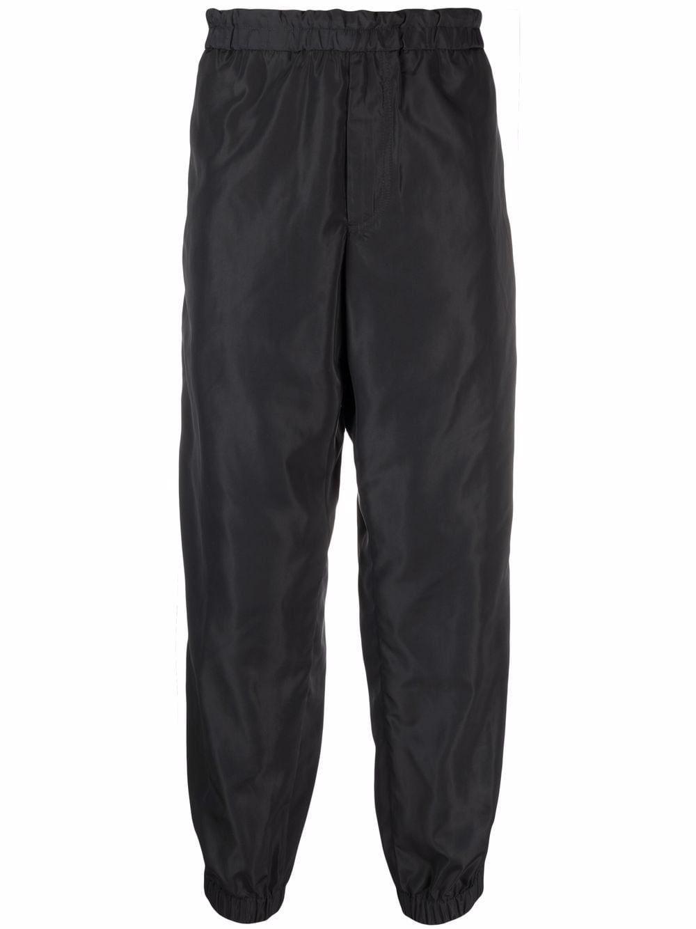 Pantalone jogging con banda